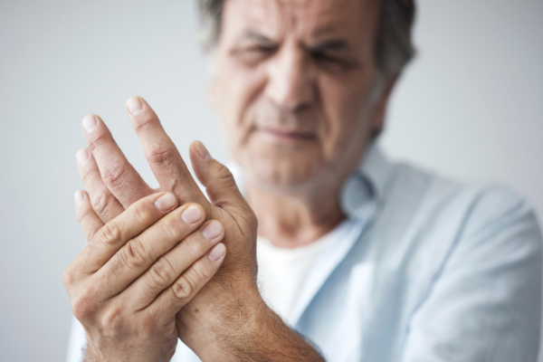 man holding strained hand
