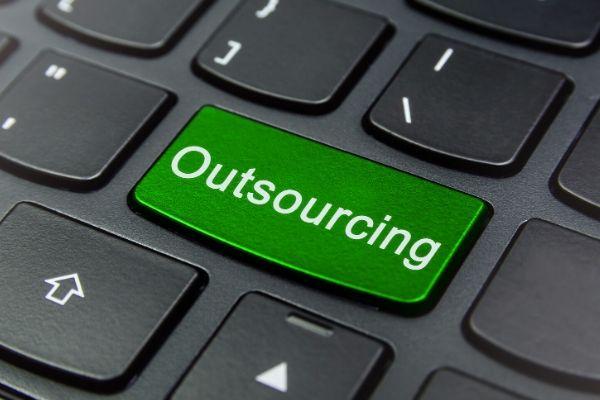 computer keyboard saying outsourcing
