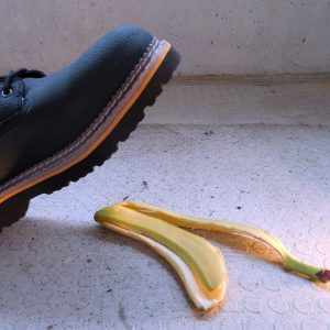 male foot about to step on a banana peel
