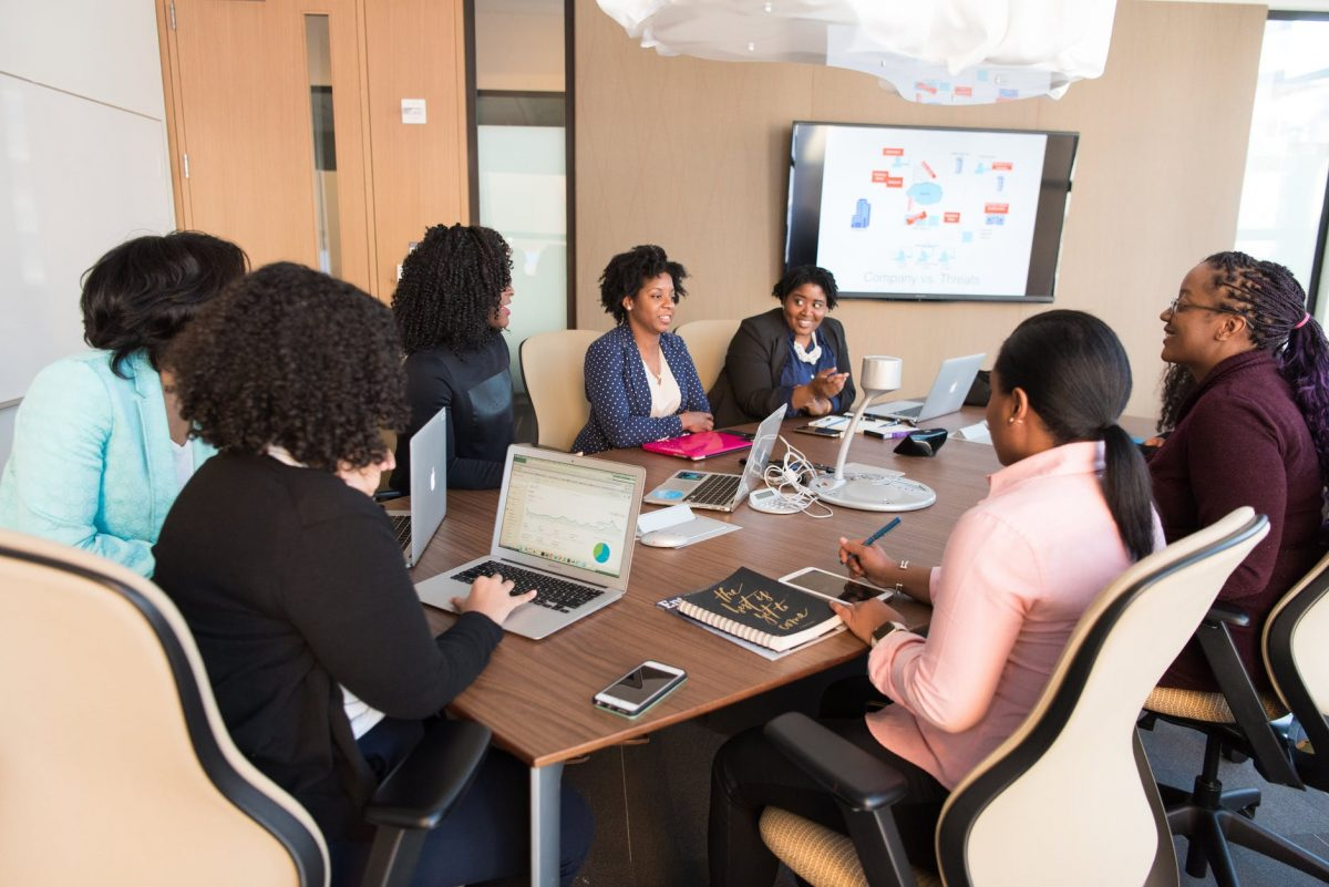 working women sitting at a conference table