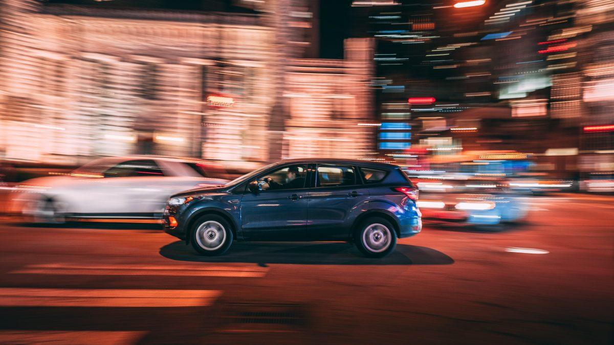 SUV on road at night