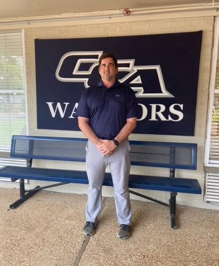 Jonathan Hardy standing at Clinton Christian Academy