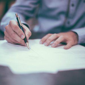 scott graham man writing on paper