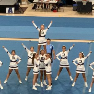 The CCA varsity cheer squad includes (l to r), front row: Annie Katherine King, Robin Neblett, Maddie Bruner, Natalie Toups, Eliza Naquin and Bethany Cole; and back row: Selena White, Haley Cannada, Avery Davis and Chloe Hodgins.